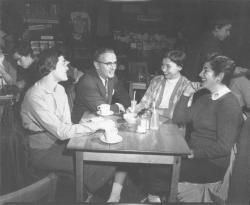 Jean Paul Mather sitting with students, ca. 1956
