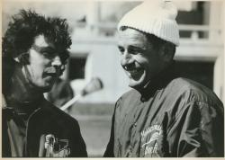 Lacrosse coach, Dick Garber talking with player at Umass vs. BC game, 1975