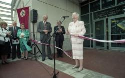 Dedication ceremonies for the Conte Polymer Center: Corinne Conte cutting the ribbon, April 12, 1996
