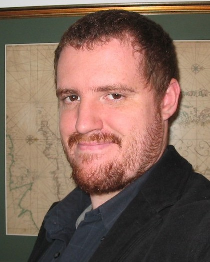 An image of Jeffery Goodhind with short red hair and beard.