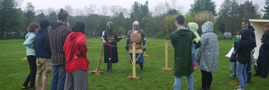 two men in armor explain fighting techniques at renaissance festival