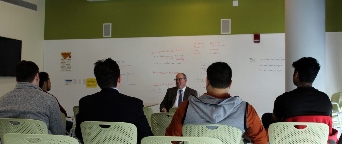 Stephen Clarke 86 Economics Meets With Students To Discuss
