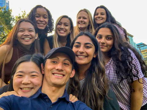 Farah Sabir and eight other University of Massachusetts students pose together in a group selfie