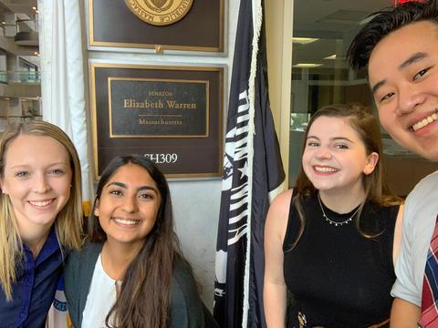 University of Massachusetts student Farah Sabir stands in the office of US Senator Elizabeth Warren with three other UMass students
