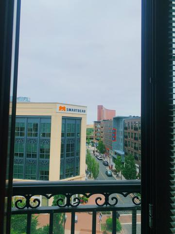 Bustling urban streets are visible from a balcony at University of Massachusetts student Jessie's internship