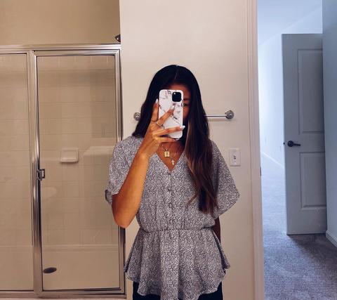 University of Massachusetts student Jessie snaps a selfie at her property management internship