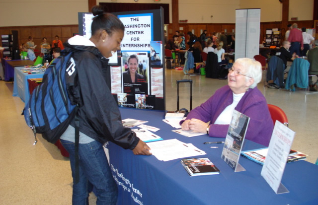 Public Health Student Receives Information At The SPHHS Career Fair
