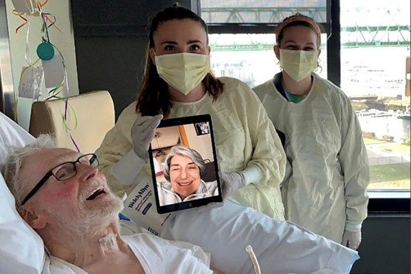 Communication Disorders alumna Alison Letvinchuk with a patient during a virtual visit