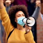 Woman holds a megaphone at a social justice rally