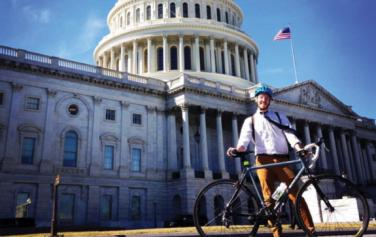 Nick Russo outside the US Capitol with a bicycle