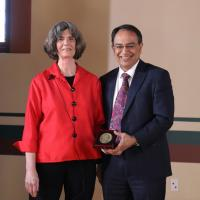 Professor Carol Heim receiving a Chancellor's Medal from Chancellor Kumble Subbaswamy