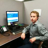 School of Public Policy student Dan Beckley at his computer at his internship