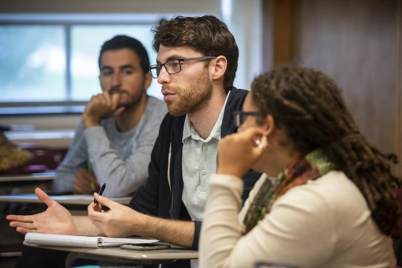 three School of Public Policy students in a classroom discussion