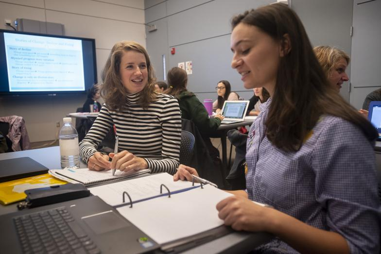Two Public Policy students working together in classroom