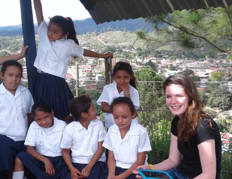 SPP student Olivia Laramie and children during her internship in Honduras