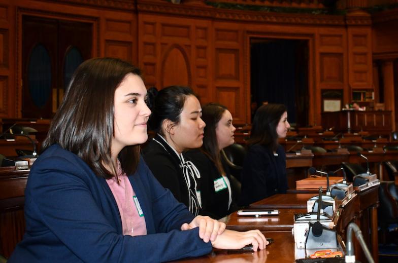 Group of students in the Massachusetts legislative chambers