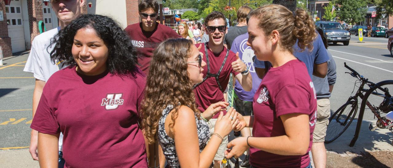 UMass Amherst students walk through downtown Amherst