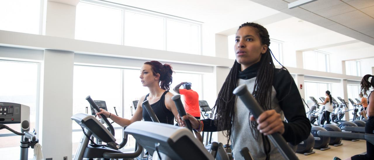 UMass Amherst students exercise in the recreation center.