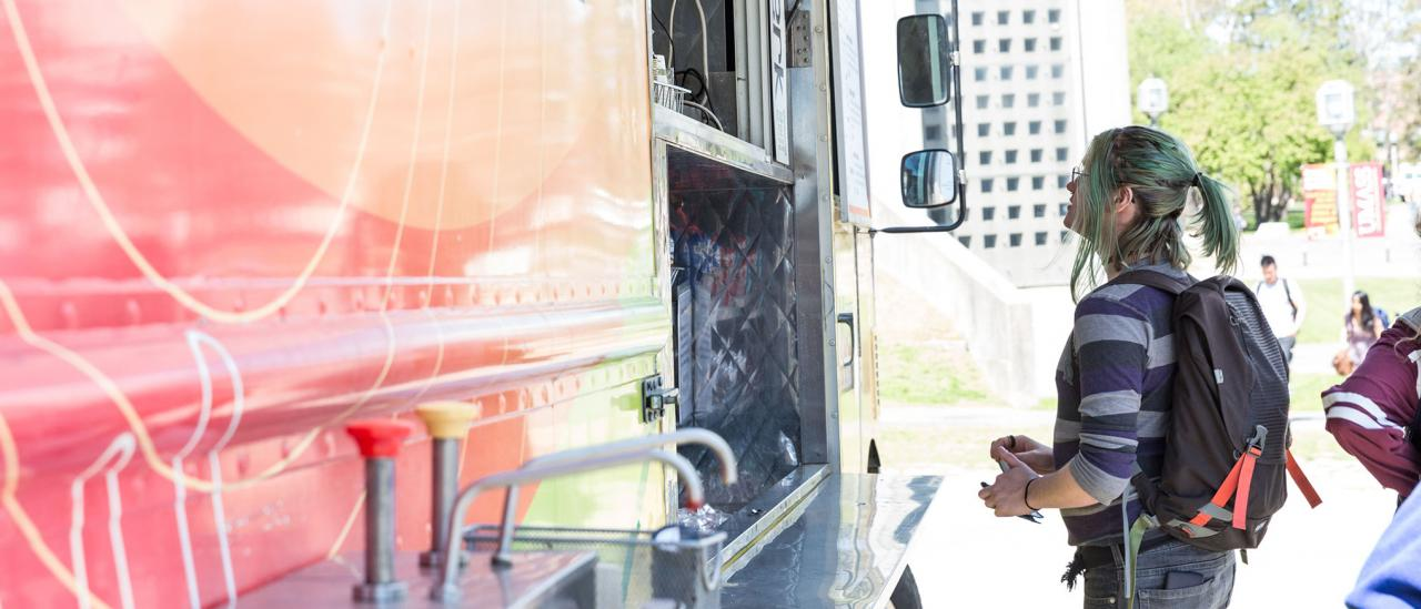 A UMass Amherst student orders lunch at an on-campus food truck.