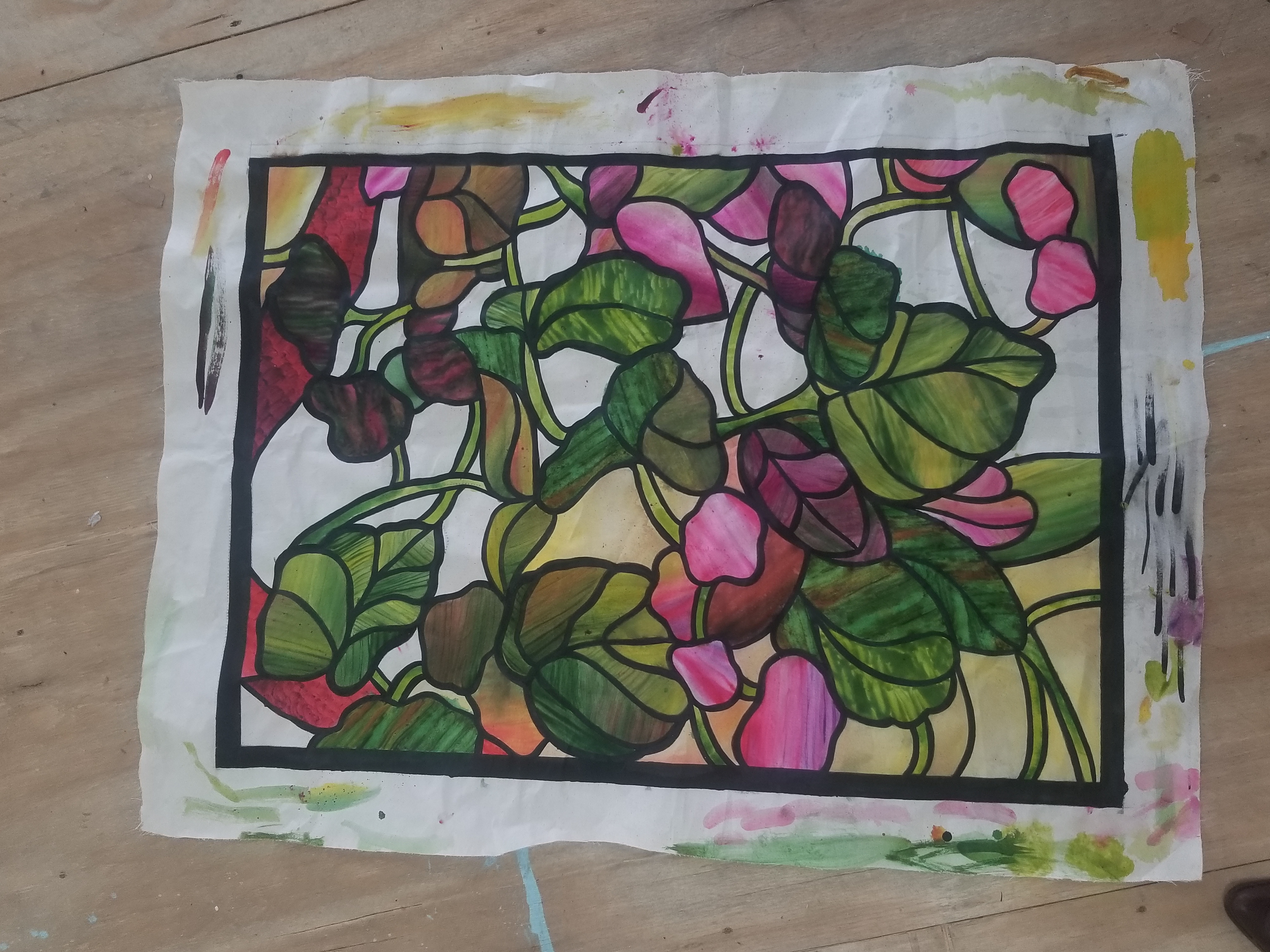 A piece of muslin fabric painted to resemble stained glass