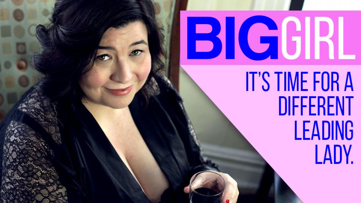 Katharine Scarborough looks up at the camera, in character as Katie from Big Girl Show. The title of the series is displayed on the right hand corner of the image
