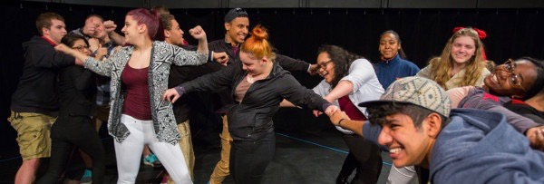 image of local high school students at a workshop with UMass Theater students