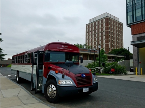UMass Transit school bus outside of South College