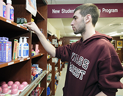Man shops UHS Pharmacy over-the-counter products