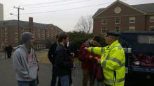 Officer Whelihan handing out stress bags to students