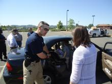 UMPD inspecting child safety seat