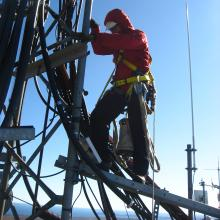 Climbing the tower at Ragged Mountain