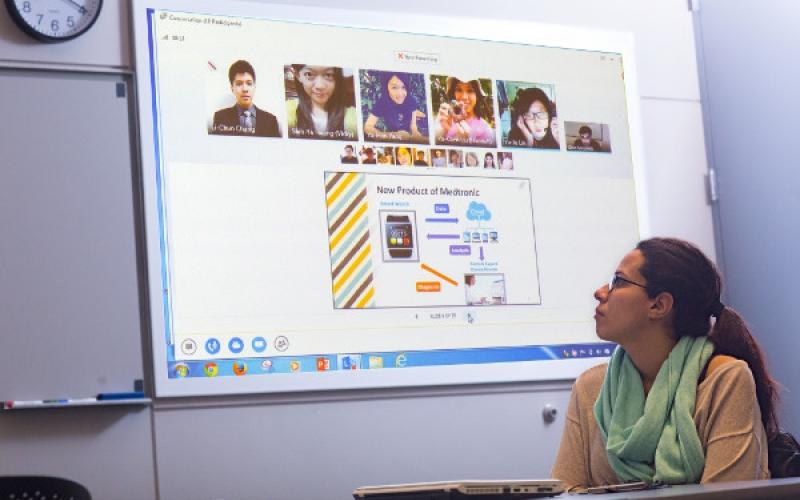Woman watching presentation