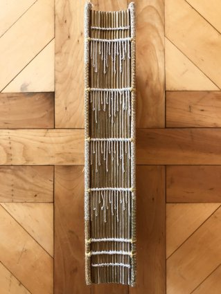 Here is an upclose photograph of an exposed book spine, revealing the threaded detail.